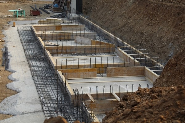 Uniform concrete forms with rebar, construction site
