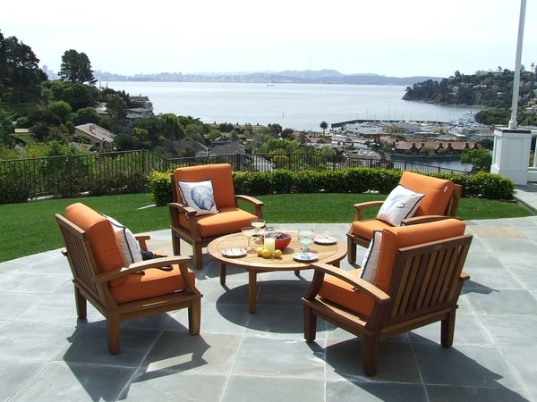 Patio furniture with dinner served overlooking the beach with stamped concrete